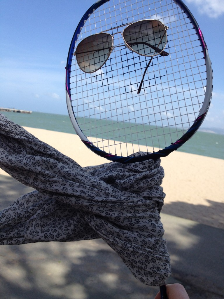 After hiking around a bit, my racket decided to do some sunbathing, but didn't want to get a tan, so wore eye and face protection to keep from getting burnt.