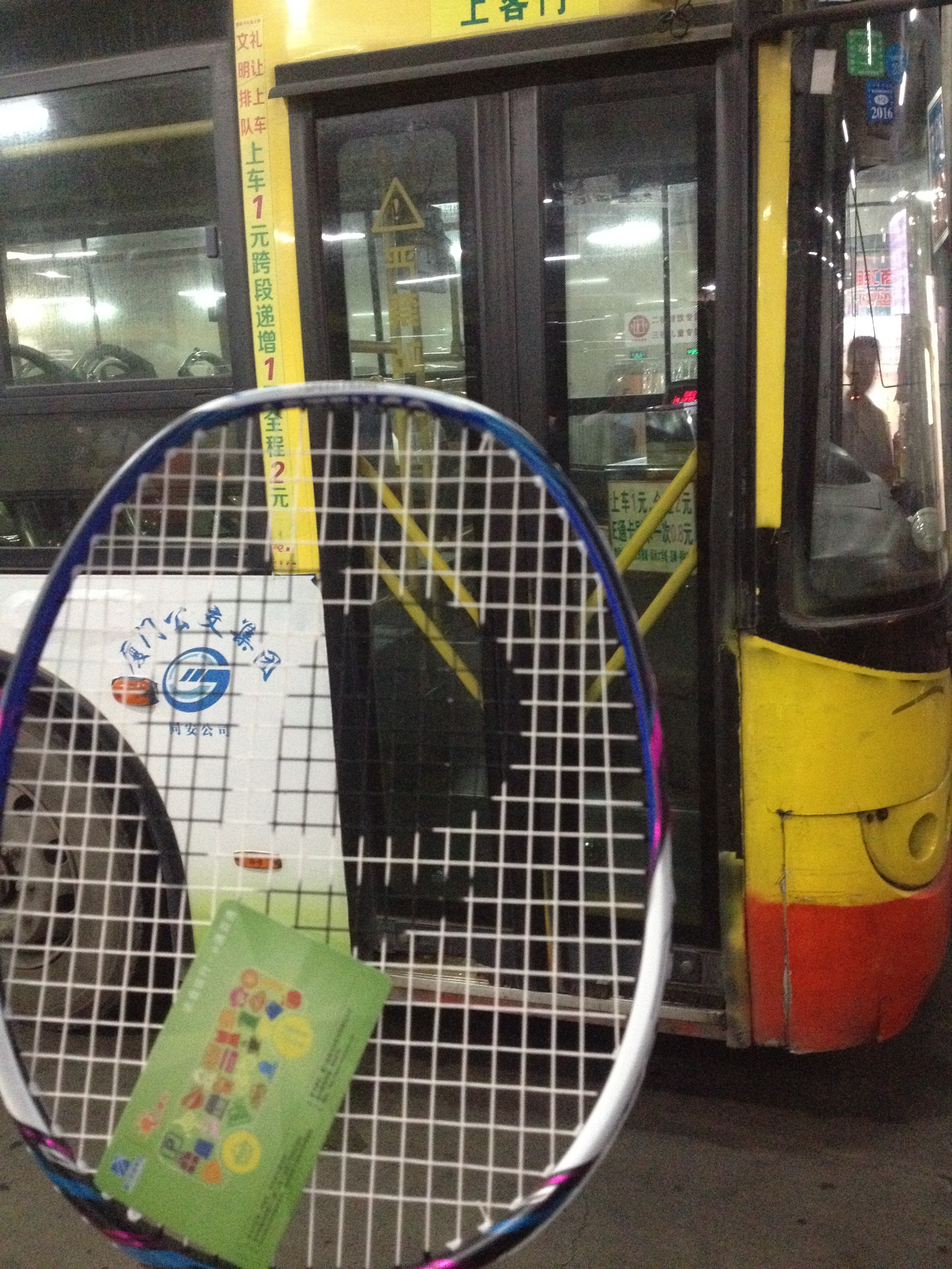 Holding onto it's own bus card, my racket can take any bus it wants to.