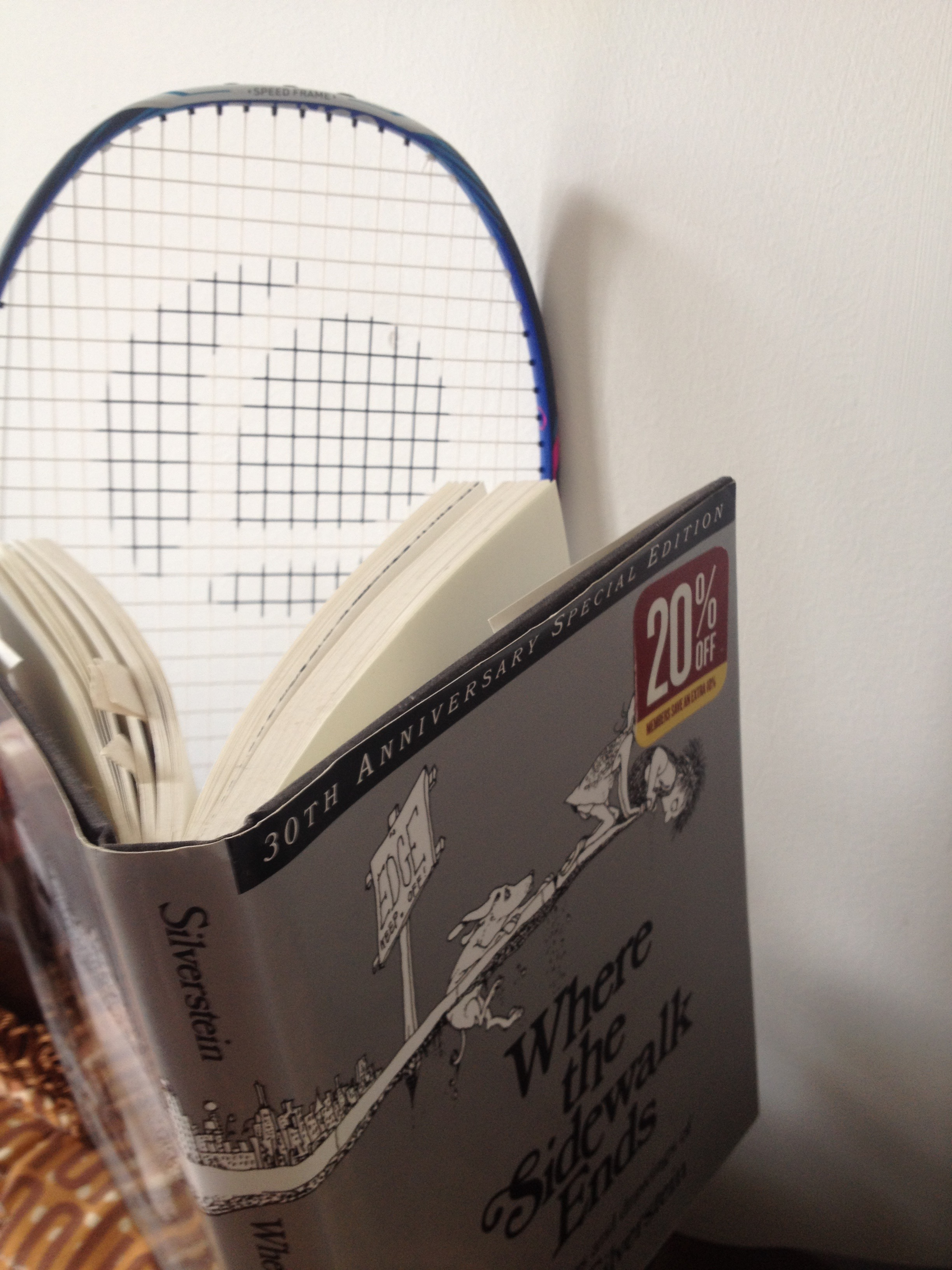 After a snack, my racket likes to read a little poetry to keep it's mind fresh.