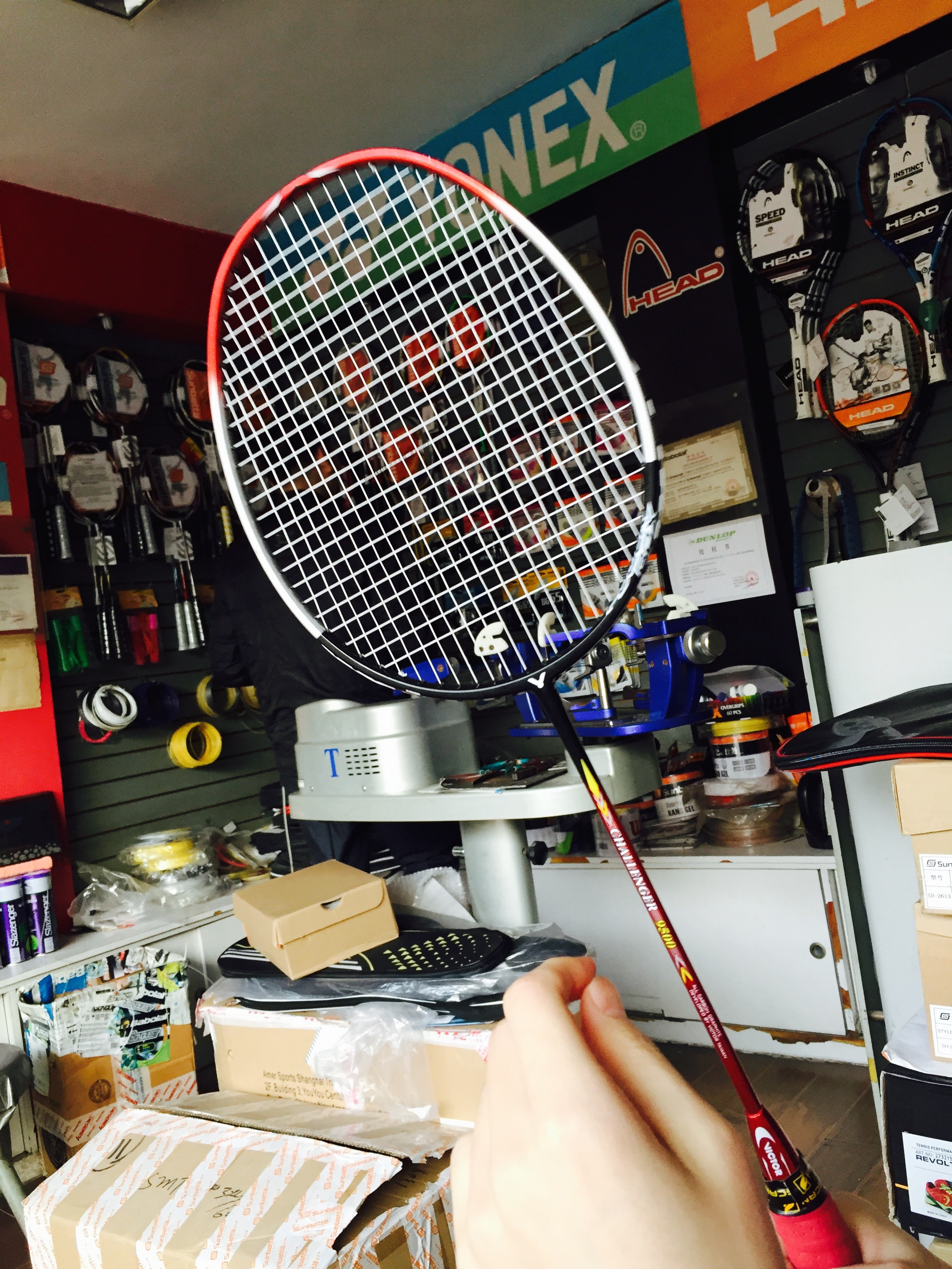 I went with my friend Xiao He to get his rackets restrung a few weeks ago. I got to watch the whole process.