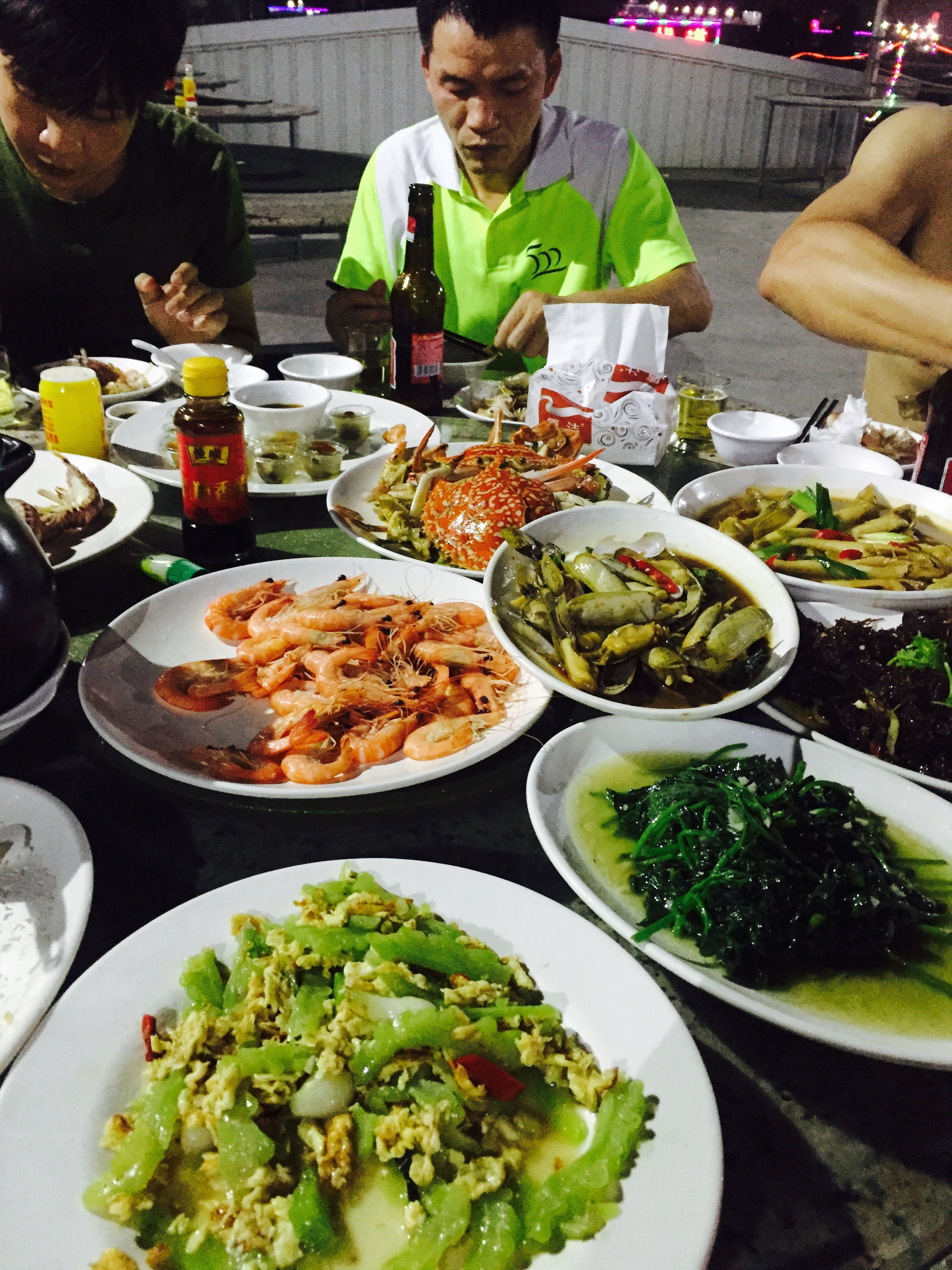 Classic Xiamen seafood dinner. Unfortunately seafood isn't my favorite to eat. My coach keot piling crayfish and stuff on my plate being a polite Chinese host. I had to yell at him to stop because I knew I didn't want to eat it, haha.
