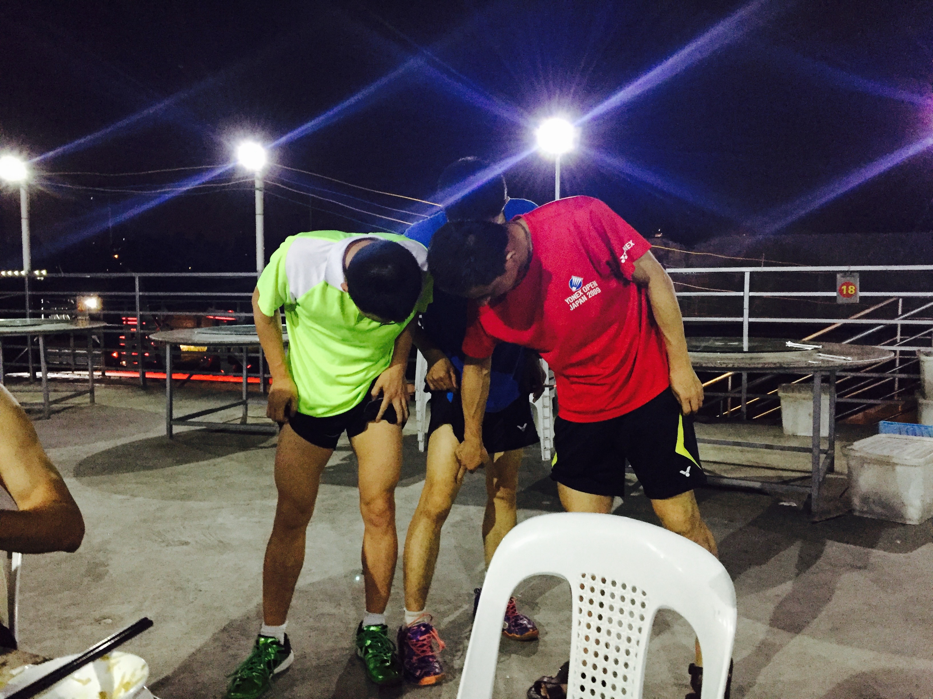 My coach (center), my coaches coach (in the red, and another guy comparing their leg muslces to see which one was bigger. In badminton, the thigh muscle is important and the bigger the better.
