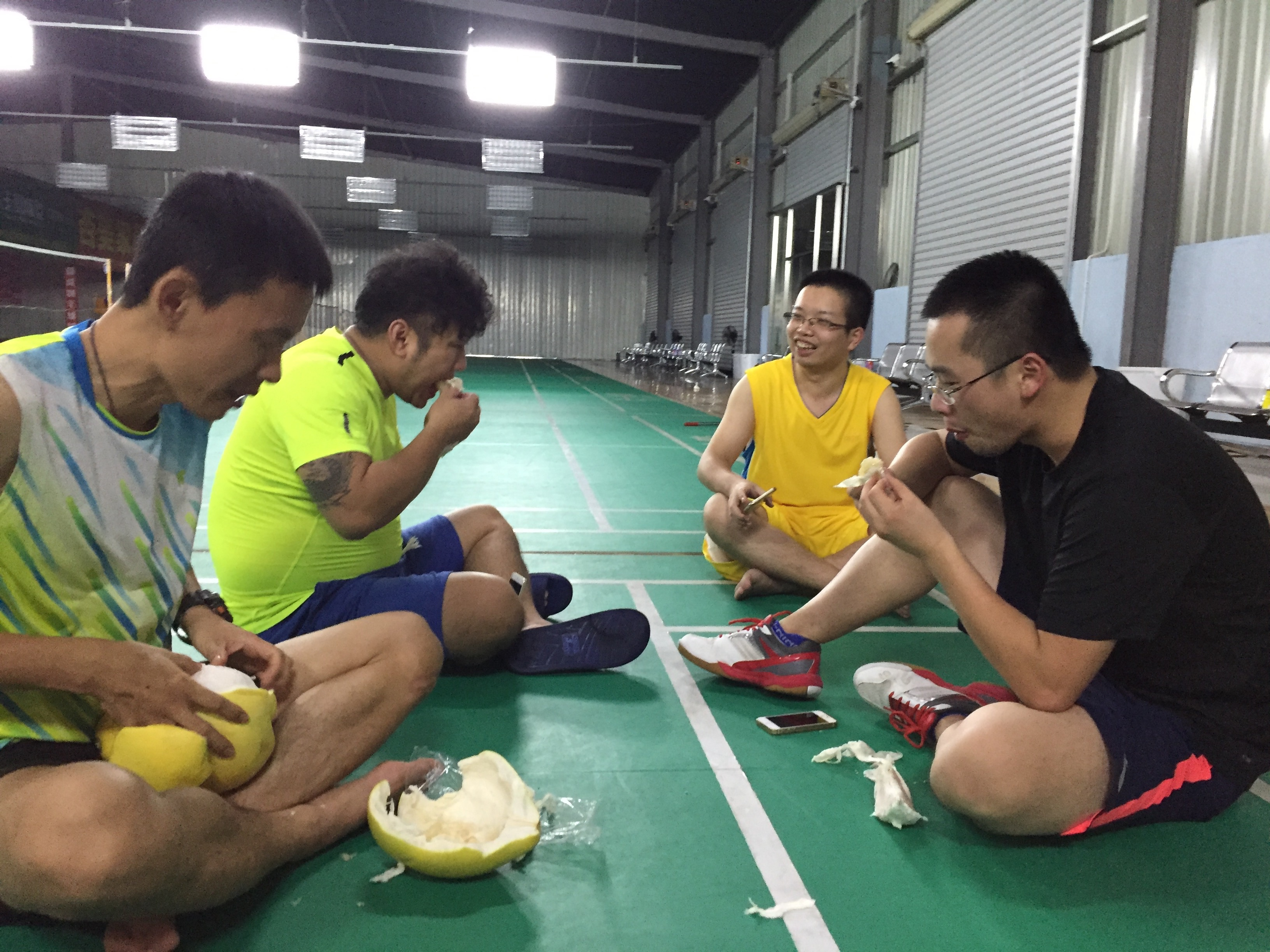 Sometimes we just plunk down right on the court and hang out. My coach brought out some pomelo fruit and proceeded to peel it with his hands. Total bad ass.