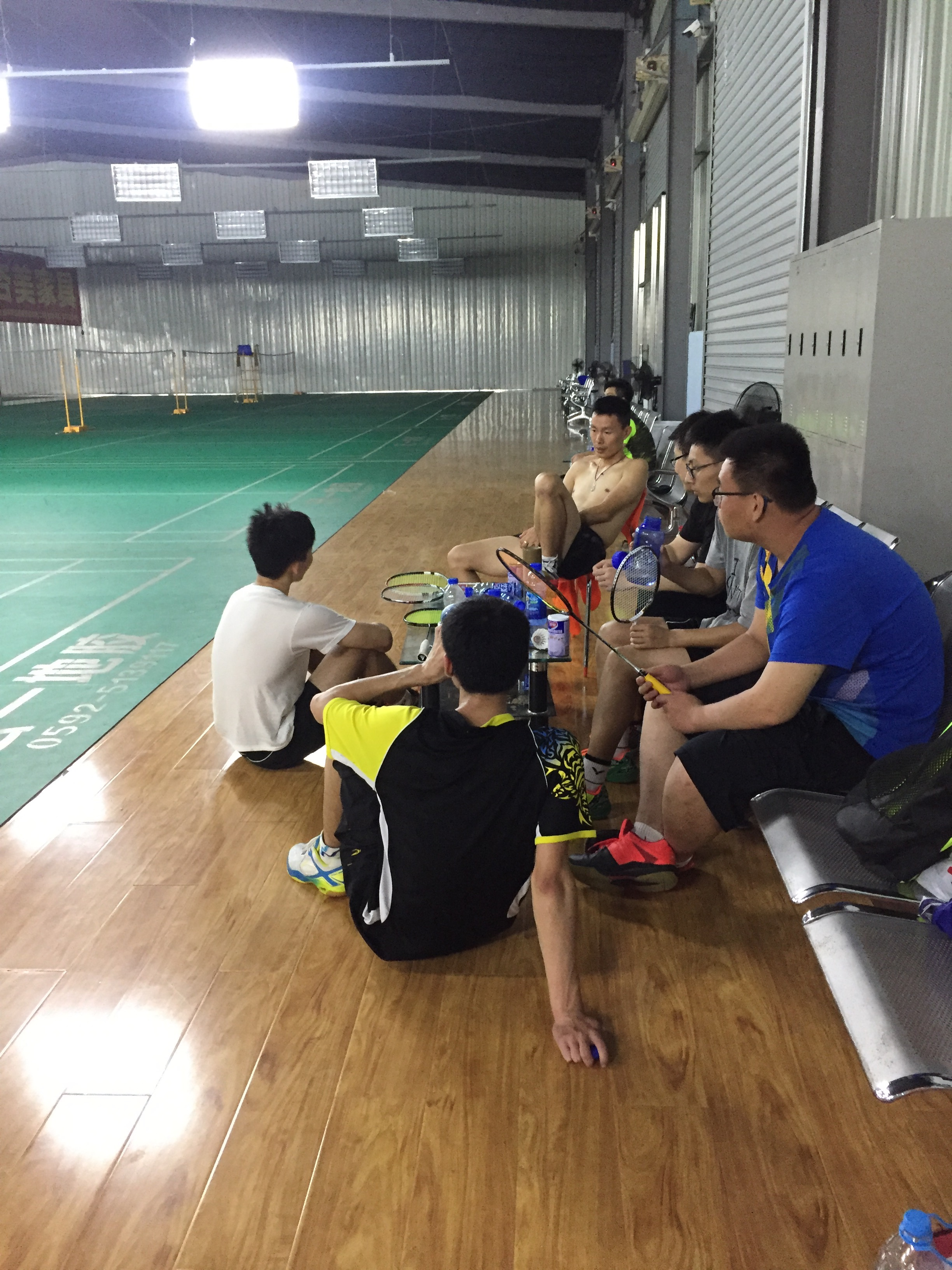 I caught a bunch of younger players sitting around my coach listening to him talk about badminton. I couldn't help but think it was like a master and his disciples.