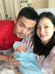 Lin Dan, his wife, and their newborn baby. The cheating videos were taken just a few weeks before she gave birth to their baby.